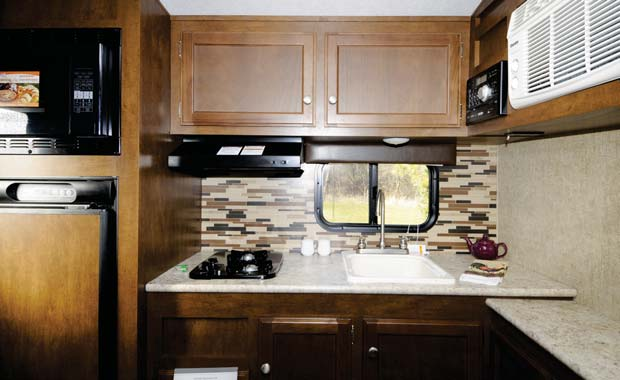 The Sonic 167 features a rear galley with ample counter space.