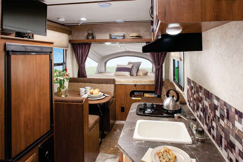 Hybrid travel trailers like the Jay Feather 16XRB have beds that extend from the front and back walls to expand your interior living space.