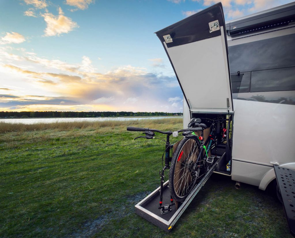A bicycle storage feature on a leisure travel van wonder rear twin bed..