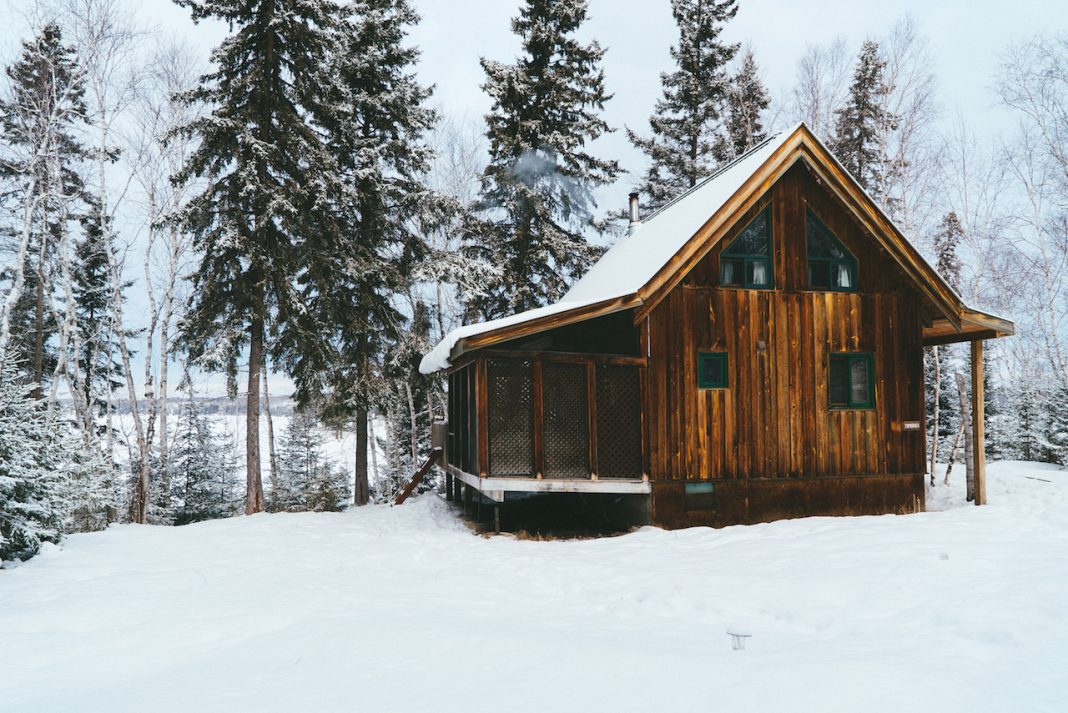 A snowy cabin in Manitoba along a lake in Whiteshell Provincial Park