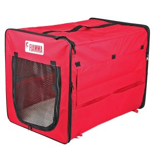 A red collapsible dog crate.